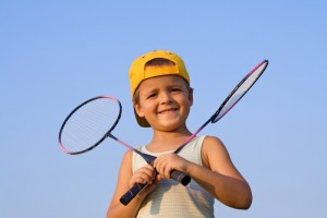 425604-boy-with-badminton-rackets